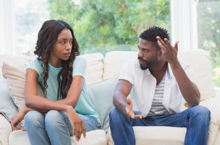 42399932 - couple having argument on the couch at home in the living room