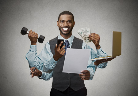 44098323 - multitasking happy business man isolated on grey wall background. busy life of company manager corporate executive. many errands concept