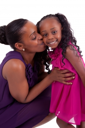 happy african mother kissing her daughter after stork talk