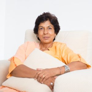 44752445 - portrait of a tired 50s indian mature woman resting on sofa at home. indoor senior people living lifestyle.