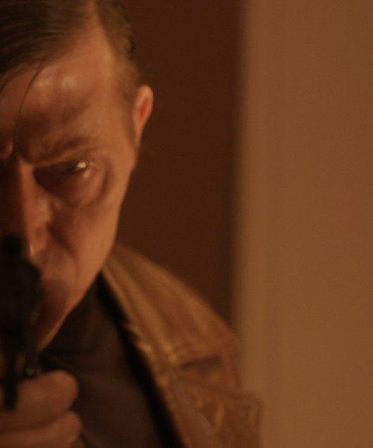 Still from MONA: David France as Guerin