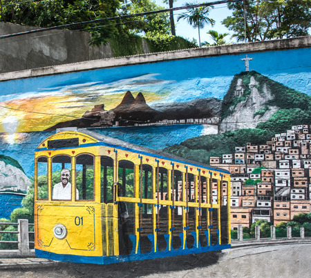 Rio de Janeiro - 55062718 - rio de janeiro, brazil - february 19, 2016: street artists painted the walls of the santa teresa district to re-opening of the tram line, which was closed down for many years