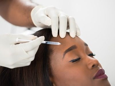 MelanMag - FaceValue - 55666735 - close-up of young woman having cosmetic treatment at beauty clinic
