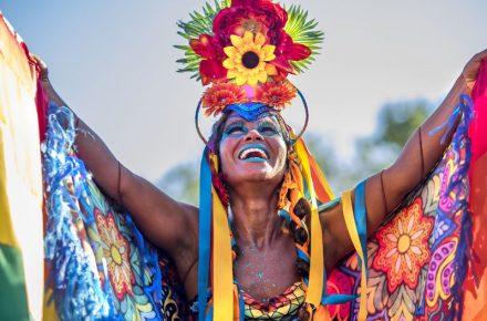 Rio de Janeiro - 55334588 - beautiful brazilian woman of african descent wearing colourful costume and smiling during 2016 carnival street parade in rio de janeiro, brazil
