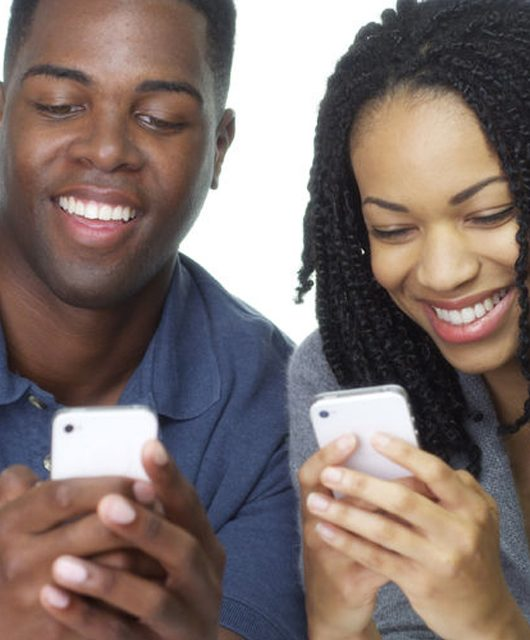 dating app - 101 ways to meet your lover, and the dating app isn't one! 33803256 - young african american couple texting on cell phones together