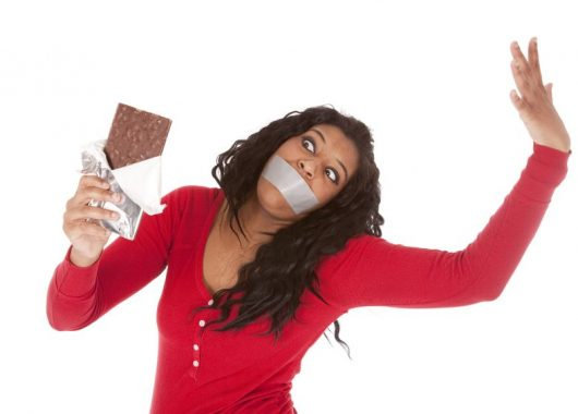 Five things you might want to consider giving up for Lent 9000876 - an african american woman wants to eat some chocolate.