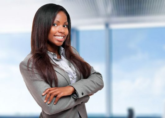 The five skills of a winning solopreneur - 62793126 - smiling black business woman in her office