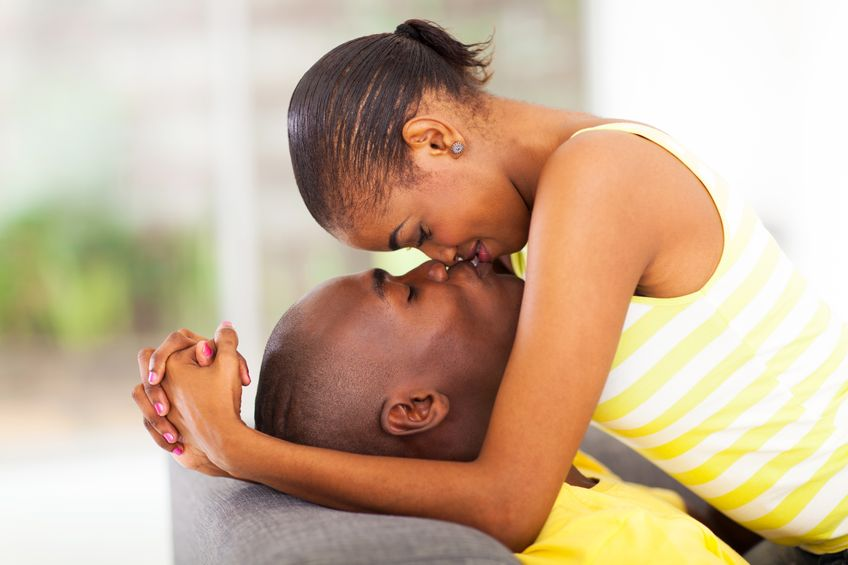 19203787 - young african american couple kissing and flirting - Five tips for enhanced intimacy in relationships