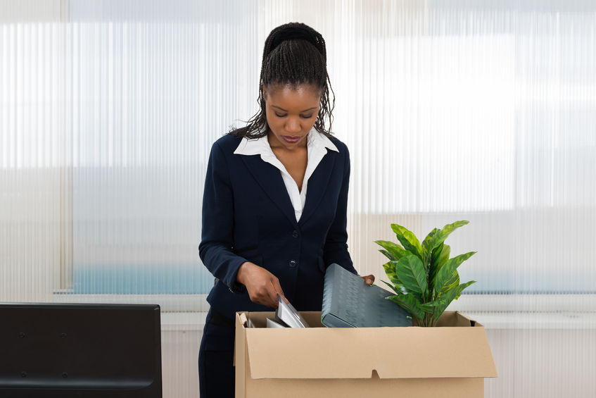48629209 - sad african businesswoman carrying box with her belongings in office How to: leave your old job like a pro!
