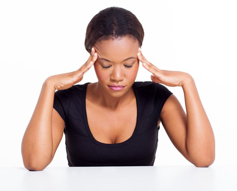 Stress: The hidden obstacle to good health - 22137316 - young black woman having headache isolated on white