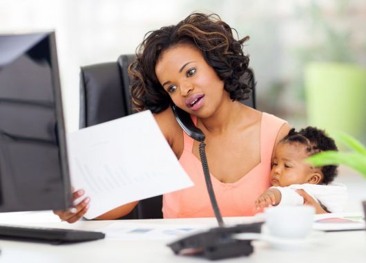 Mums: How to keep your sanity while launching your business! 22061969 - african american woman with baby girl working from home