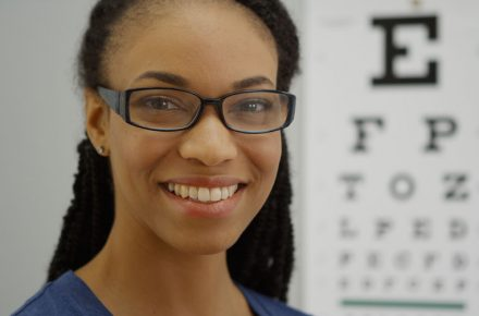 Look after your eyes; get them checked regularly - 50870130 - black woman wearing glasses smiling