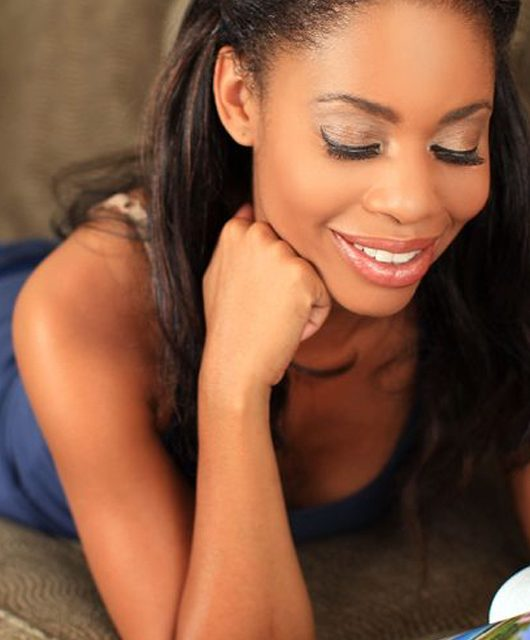 5583420 - woman reading a magazine on the couch - Representation in magazines: where are the black women?