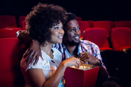38489243 - happy young couple watching a film at the cinema 10 Adventurous Ways to Spend Your First Date