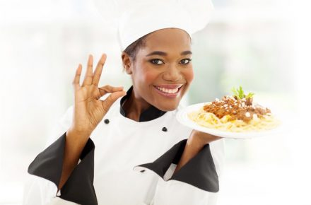 21512949 - attractive young african chef with delicious pasta dish - 50 signs that prove you are a good cook!