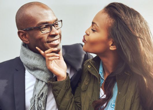 47837288 - coquettish young african american woman on a date with a handsome man playfully puckering up her lips for a kiss Is the idea of a perfect marriage just a myth?