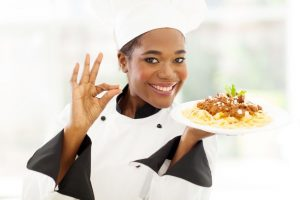 21512949 - attractive young african chef with delicious pasta dish - 10 things to consider before opening your restaurant