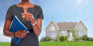 How to be a property millionaire - 73426177 - african-american realtor woman with key.