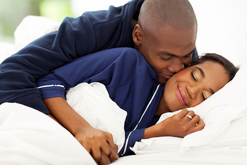 21512930 - smiling african man in bed kissing wife in bed What Women Really Want In Bed!