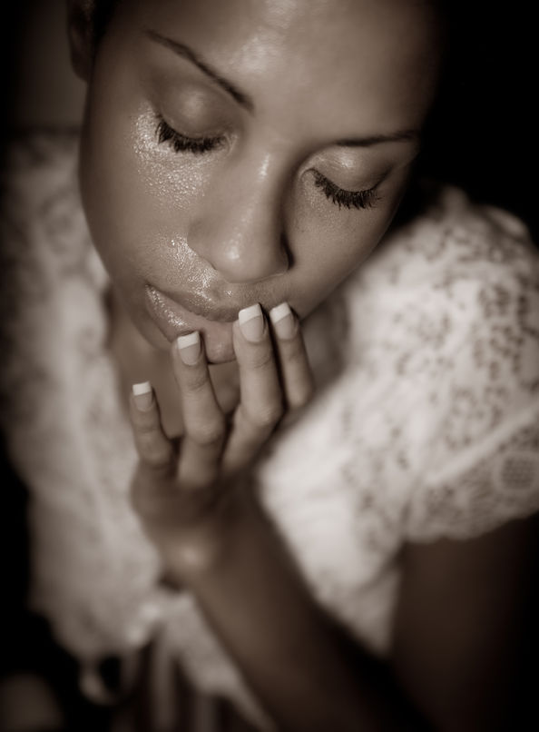 6 top tips to combat oily skin! 38627377 - sepia image of a contemplating african woman.