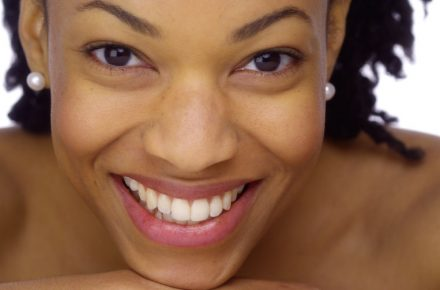 How to design a skincare regimen 33804572 - sweet african woman showing off her pearly whites