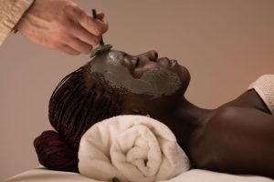 34555867 - beautiful african woman having clay facial mask applying by beautician Have you tried a DIY Facemask lately?