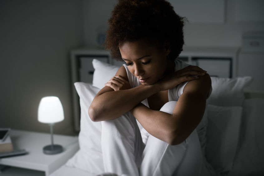 sad depressed woman sitting in her bed late at night, she is pensive and suffering from insomnia Take back control of your PCOS the natural way