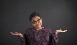 "What is 'Brain Fade' and how do we deal with it? 42995698 - south african or african american black woman teacher or student posing with an ""i don't know"" gesture on a chalk blackboard background inside"