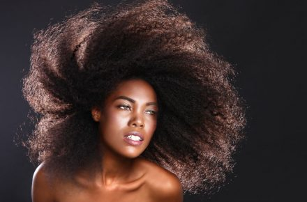 26129347 - beautiful stunning portrait of an african american black woman with big hair Melanmag Loves: Essentialle and Shea Moisture Smooth & Tame