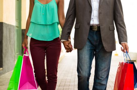 39882971 - black tourist heterosexual couple walking in the streets of casco antiguo in panama city with shopping bags. cropped view of man and woman holding hands Spend your 'black pound' in the 3 Gifts Challenge this Christmas