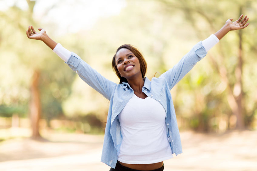 30685346 - happy african woman with arms outstretched outdoors How to silence that negative voice in your head!