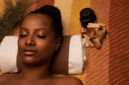 Get the glow: use these top tips to maintain healthy skin this winter 73508267 - close-up image of african-american woman with beautiful glowing skin enjoying spa treatment