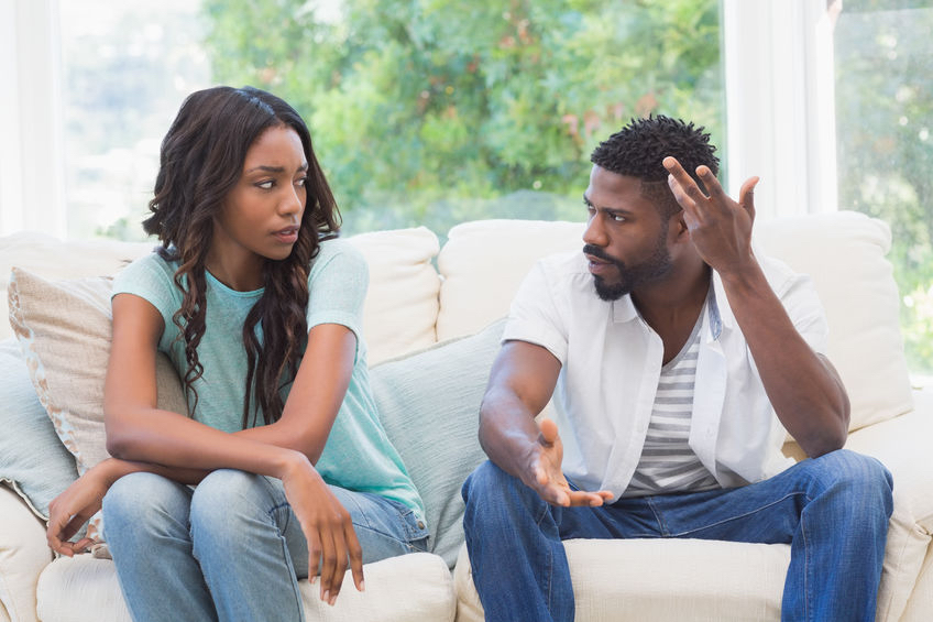 Do women brought up by single mothers' struggle more in relationships? 42399932 - couple having argument on the couch at home in the living room