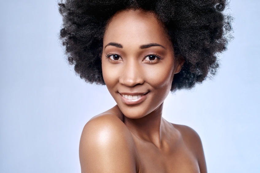 45972216 - portrait of beautiful black african model smiling in studio with smooth complexion flawless skin 10 simple tips to help you grow healthy Afro natural hair