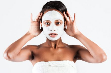25489404 - young african woman in studio doing body care with refreshing facial mask for young and beautiful skin and relaxation Which face mask to choose for your skin problems