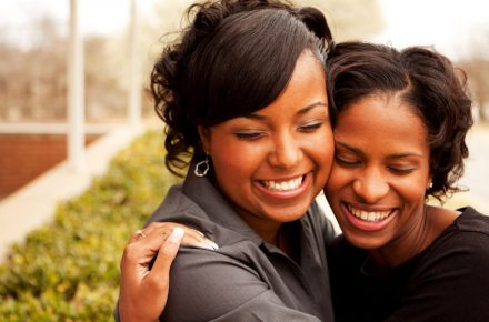 77299865 - happy african american women laughing and smiling. Six simple ways to support your bestie who's starting a business
