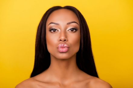 87791136 - pampering, lips correction, dermatology, dream, healthcare concept. cose up cropped photo of afro gorgeous charming brunette with ideal face sending an air kiss, so romantic! Everything you didn't know about Botox