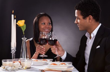 19400023 - portrait of romantic couple toasting red wine at dinner Seven tips for getting back into the dating game