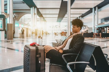 92395427 - sad cute young brazilian female is sitting in waiting space of modern airport with huge suitcase; upset curly african american girl with luggage in waiting room of contemporary terminal Have you got a flying phobia?  The top 10 myths debunked