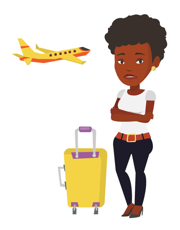 72871626 - young woman suffering from fear of flying. Have you got a flying phobia?  The top 10 myths debunked