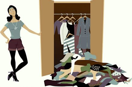 73280989 - dissapointed woman looking at her wardrobe, pile of clothes falling out of it, eps 8 vector illustration 5 Pieces of clothing every woman should have in their wardrobe