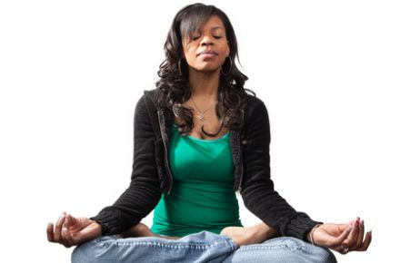 24591225 - serene looking black woman in yoga lotus position 6 Things Meditation Can Do for You